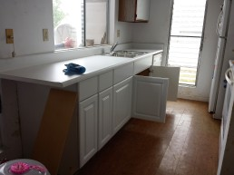 After a long day, the replacement of the kitchen cabinet was completed with a new sink, new cabinets and new countertop.